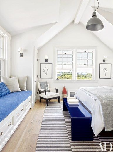 One of the twins' rooms is furnished with a pendant light by Schoolhouse Electric & Supply Co., a Victoria Hagan Home Collection armchair, a bench by Room & Board, and a Ralph Lauren Home carpet | archdigest.com