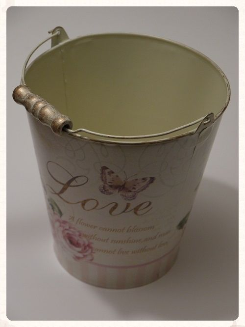 One large bucket in a cream colour with pink green and gold details These baskets would look stunning in the centre of your tables filled with