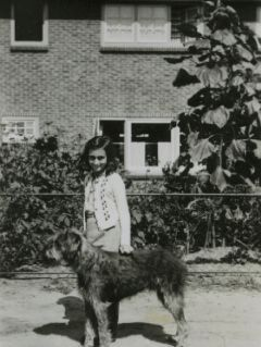 1940 - Anne Frank & her dog- May they both rest in Heaven with God.
