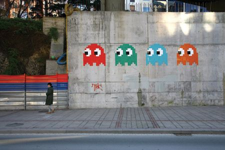Graffeti artist - Invader - uses mosaic tiles that form space invader characters, in this it's the ghosts from pacman