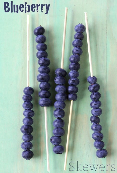 Blueberry skewers are a festive accouterment to a lemonade fizz.