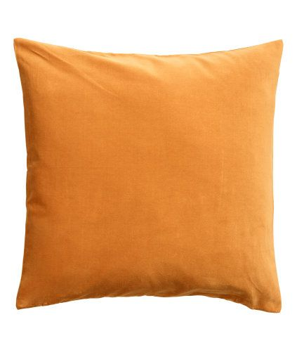 Dark orange. Cushion cover in cotton velvet with a concealed zip.