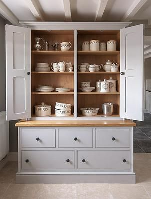 hand painted housekeepers cupboard in Farrow & Ball Pavillion Grey. Specification: natural oak surface, patine cupboard knobs, ash dovetailed drawer boxes, traditional cornice, torus skirting, tounge and grooved end panels. H 205cm x D 60cm x W 150cm-  Cheshire Furniture Company