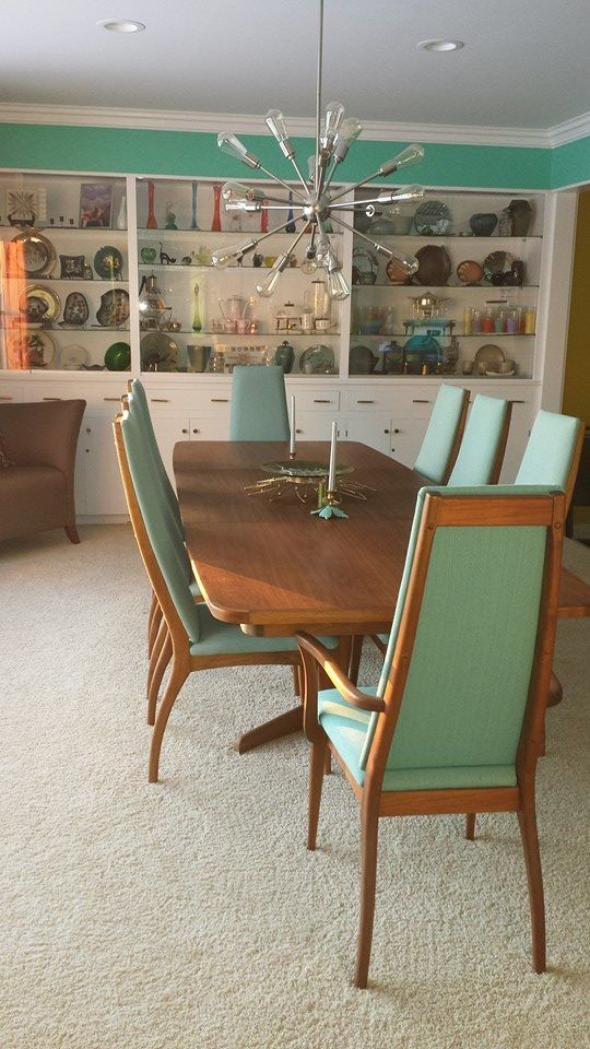 Cute teak table--one of my friend's parents have this set...