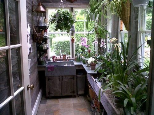 Someday I'd love to add a greenhouse type of room on to the back of the house.  This one would be perfect!