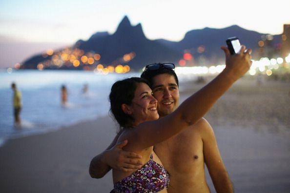 A couple takes a selfie photo on Ipanema beach on June 8 2014 in Rio de Janeiro Brazil