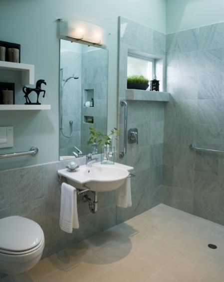 Great space! Barrier-free accessible shower opens to whole room with grab bars and roll under sink.
