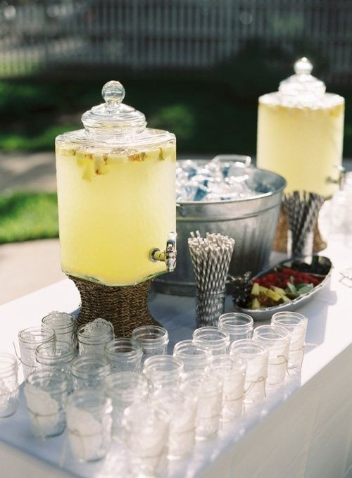 Drink dispensers with good ole southern lemonade are the perfect touch for a western wedding!