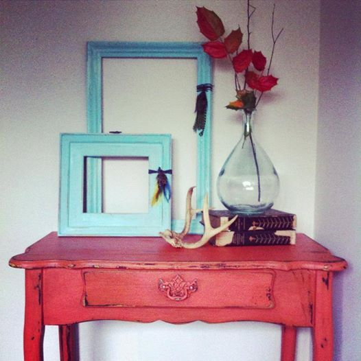 vignette by refound vintage using farmhouse paint colors coral (on the table) with teastain and turquoise on the frames