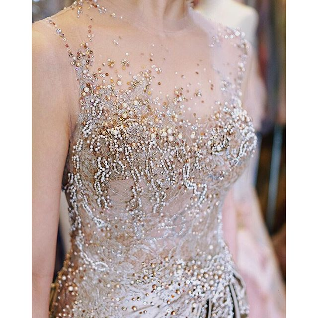 """""""Because a dress that looks great from far, should look breath-taking even this close up... #fabrictransformation #details #swarovski #pearls #dressdetails #gowndetails #handstitched #hautecouture #breathtaking #amazingdress #beautifuldress #artisancrafted #highfashion #couturier #bespoke #RuslyTjohnardi #RuslyTjohnardiAtelier"""" Photo taken by @ruslytjohnardiatelier on Instagram"""