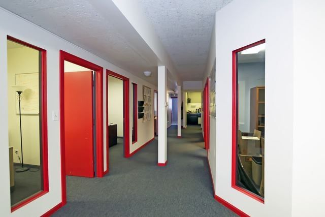 4 Private Offices, Reception Area, Conference Area, Lounge Area, Kitchen, 2 Baths, and 6-Car Parking.