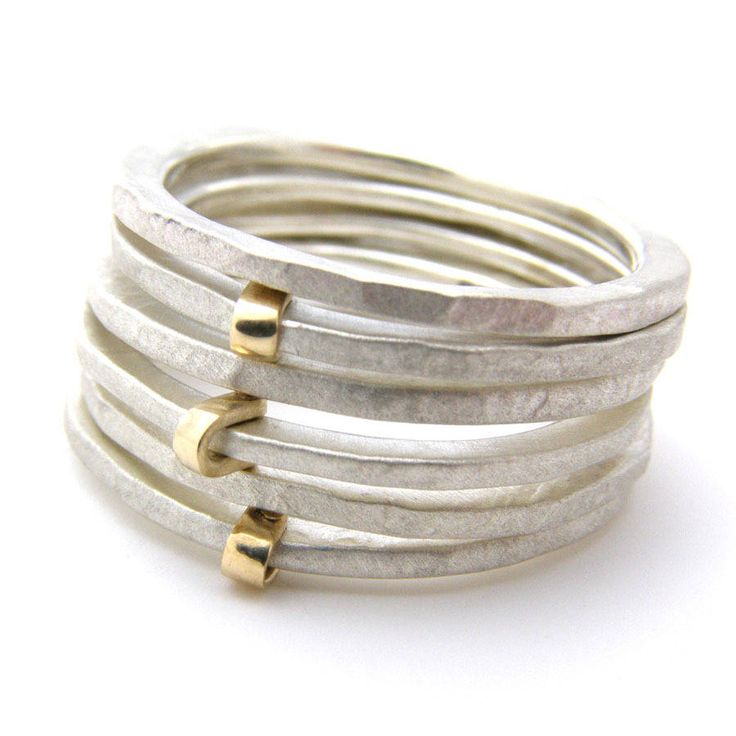 Beautiful hand made sterling silver and 9ct gold fold ring by the fabulous British designer Jane Kenny.