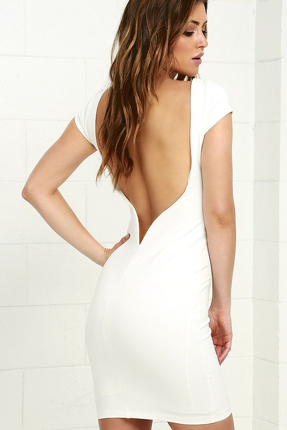 We dare you to flaunt your figure in the Daring Dame Ivory Backless Bodycon Dress! Medium weight, stretch knit shapes this curve-loving dress with a bateau neckline, cap sleeves, and a darted bodice. Backless silhouette has a hidden V-bar for added structure, above a tube skirt.