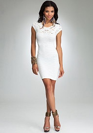 Sheer detail at back, lace adorned neckline, floral texture throughout and bodycon design give this bebe dress a super feminine approach to cocktail styles. Features super soft stretch and cap sleeves. Top it off with a cropped moto jacket for some edge.