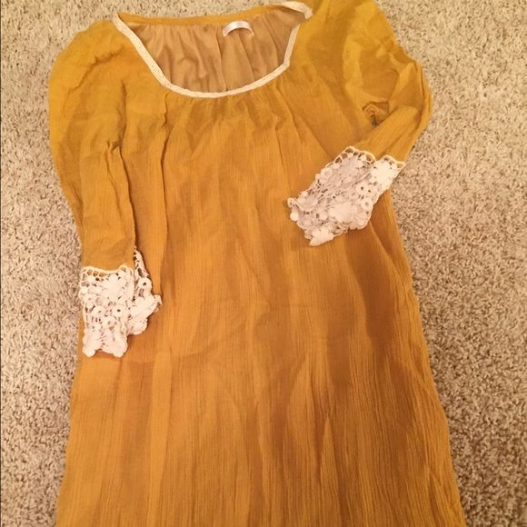 Pink blush yellow maternity dress Excellent used condition only wore 1x mustard yellow maternity dress with crochet trim on bottom and sleeves. Super comfortable and would fit up to a medium! Dresses