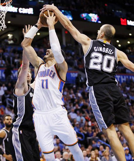 San Antonio's Manu Ginobili (20) and Pau Gasol (16) defend Oklahoma City's Enes Kanter (11) during an NBA basketball game between the Oklahoma City Thunder and San Antonio Spurs at Chesapeake Energy Arena in Oklahoma City, Friday, March 31, 2017. San Antonio won 100-95. Photo by Nate Billings, The Oklahoman