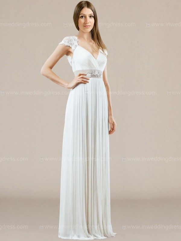 Inspired by the most beautiful woman of the Ancient Greece, this wedding dress for beach wedding charm us with the way the Lace caresses the shoulders and highlights the back. Natural waist is defined by the belt embellished with lace appliques. The perfect lines of the skirt falls to the ground for its seductive aesthetic.