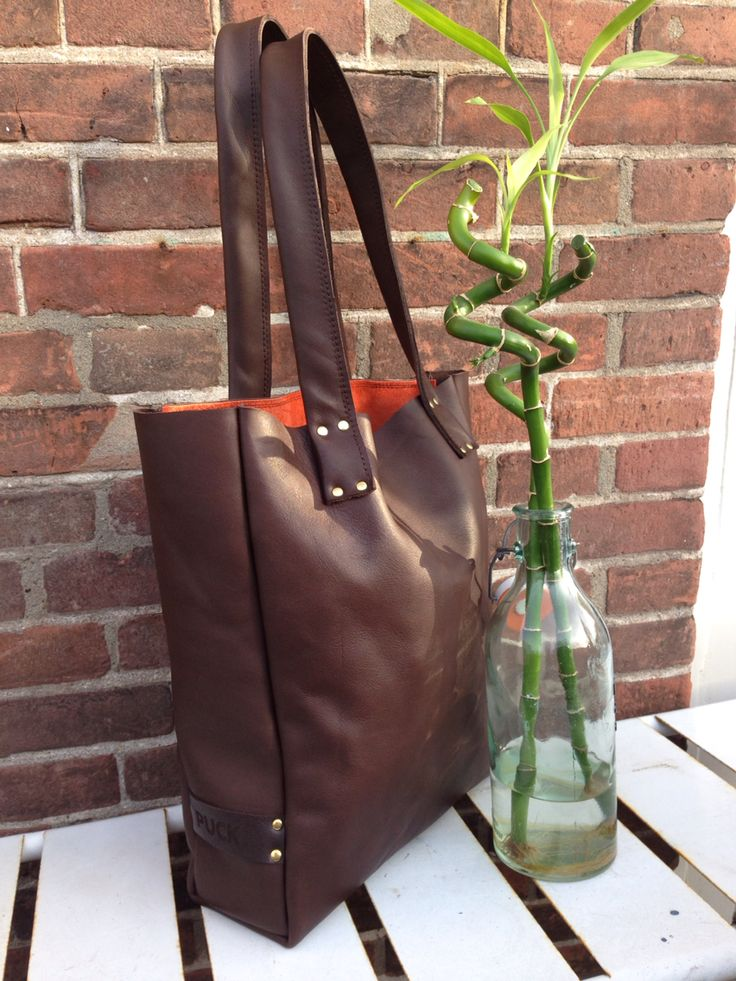 Handmade leather bag! Chocolate brown with a touch of orange inside. Simple and Elegant
