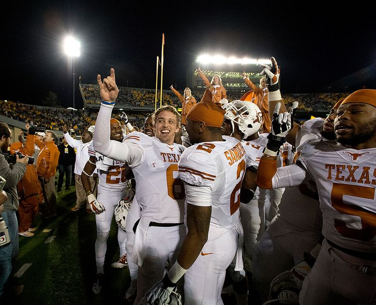 """Case McCoy (6) and the Longhorns sing """"The Eyes of Texas"""" after defeating West Virginia in overtime."""