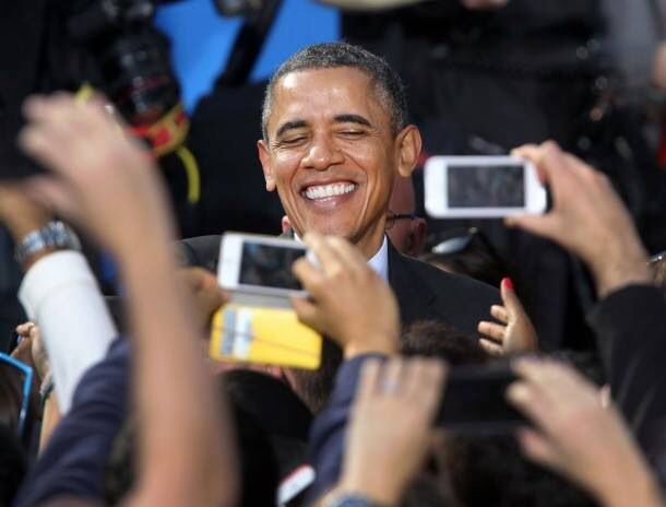 President Obama and smart phones all trying to capture the moment.