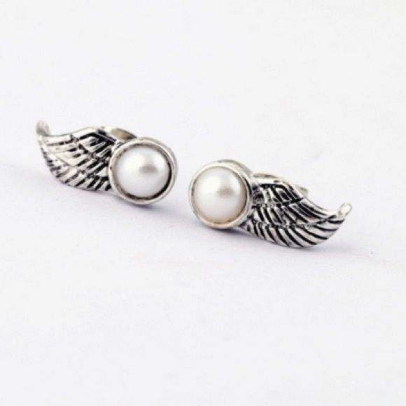 Winged Pearls Stud Earrings Never been used, cool winged faux pearl stud earrings. How rockstar can you get??  Wear this pair at rock concerts or any event you feel like rockin'   Jewelry Earrings