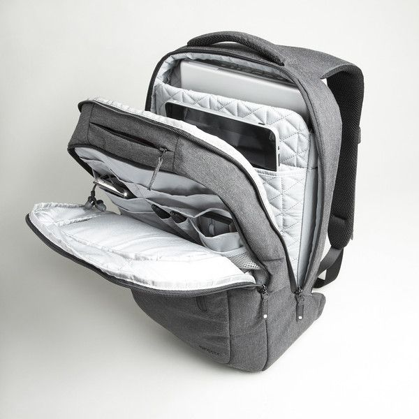 """Incase Heathered Backpack - Product Details:  Durable spun-fibre heathered fabric  Soft quilted interior lining  Fully padded notebook compartment (fits up to 17"""" MacBook Pro)  Internal slip pocket for iPad  Multiple internal organizer pockets  External quick access iPhone pocket with plush faux-fur lining  Hidden stash pocket on back panel  Padded shoulder straps for increased comfort and ergonomic support and padded mesh back panel with integrated air-flow channels  ..."""