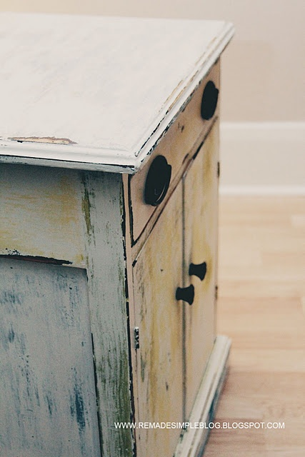 Patchwork Distressed Side Table (a great idea for ugly yet solid laminate furniture)