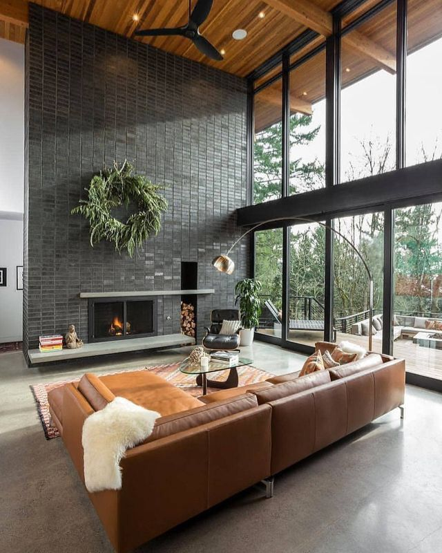 Large Windows Large Gray Fireplace And Leather Couches In A Modern Boho Living Room Relaxing Living Room Home Living Room House Interior