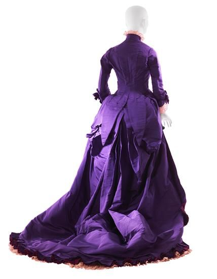 ca. 1876 Worth afternoon dress Purple taffeta; pink machine-made lace; fuchsia, navy blue, and purple silk fringe; purple reversing to fuchsia taffeta ribbon; fuchsia taffeta lining Museum of the City of New York