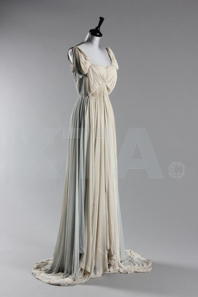 ~Madame Grès ivory and dove-grey draped jersey evening gown, 1940s, un-labelled, fastened centre-front by hooks and eyes, with ivory front, reversing to grey at the back with deep V back, pointed, trained side panel~