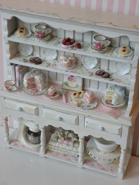 Shabby chic house - I love the paper on the shelves.