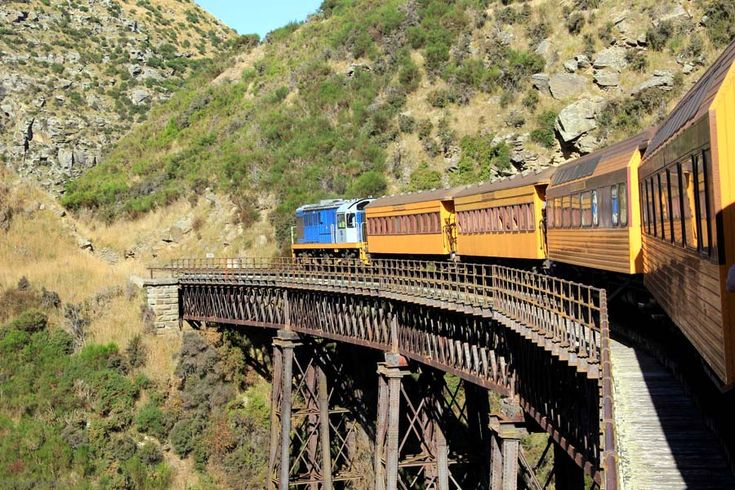 Dunedin Taieri Gorge Train Running over a Bridge from Mark at Travel Wonders of the World. #New #Zealand