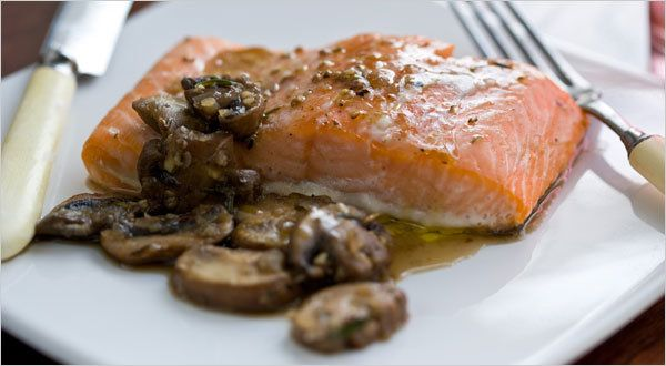 You'll never want to cook salmon any other way after you make this It steams above a pan of water in a low oven, resulting in a very moist piece of fish The mushrooms are  wonderful on top or on the side.