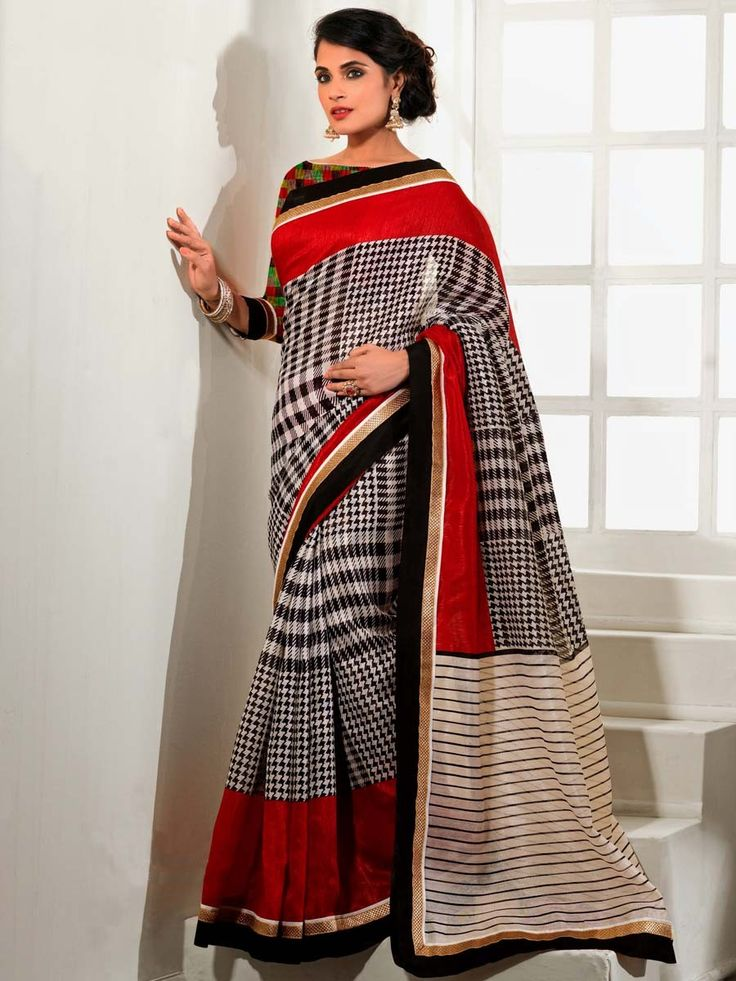 Imposing black and off white color checks and stripes print art silk saree. Item code: SDHI604  http://www.bharatplaza.com/celebrity/richa-chadda.html