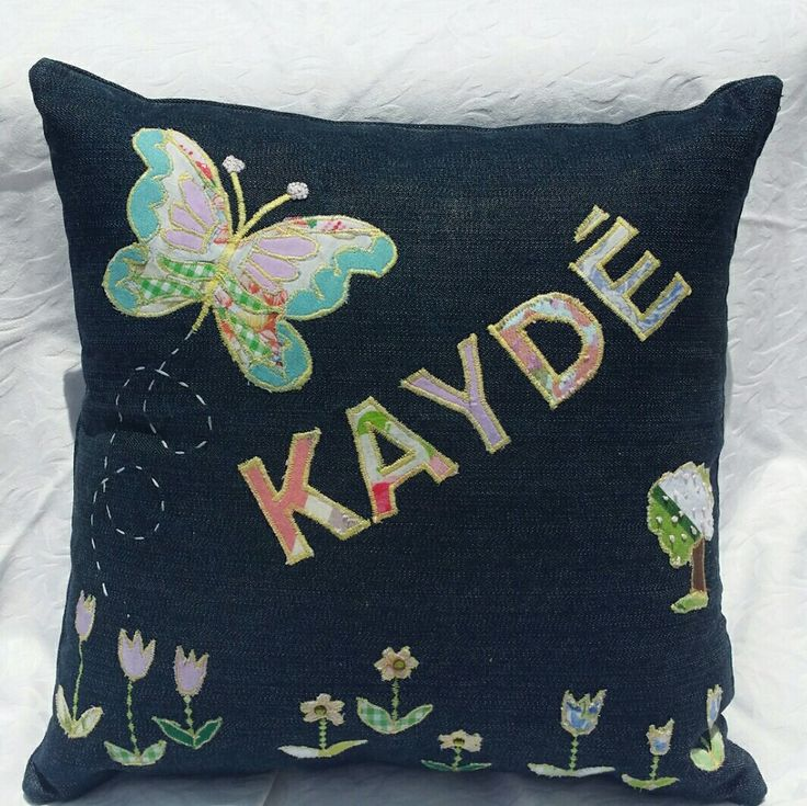 Denim applique throw pillow. Butterfly themed.