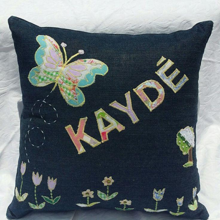 Denim applique throw pillow. Butterfly themed.