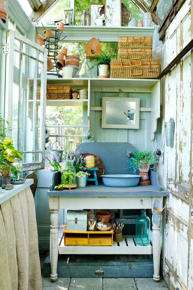 The potting bench inside this backyard retreat serves as a place to clean up inside the backyard retreat—a gardener's dream spot!