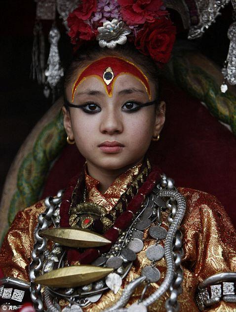 Nepal's living goddess locally known as the Kumari, Samita Bajracharya, watches the last day of Rato Machhendranath chariot festival in Patan, outskirts of Katmandu, Nepal