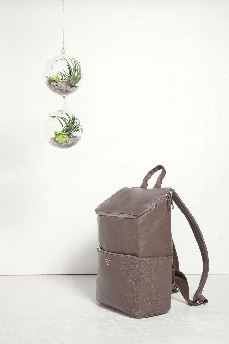 Backpack with top zipper closure. Side slit pockets and front zipper pocket.