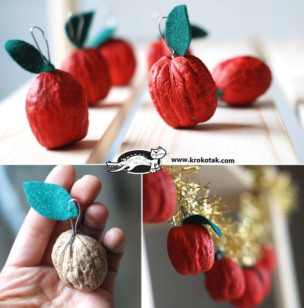 Avec des noix, on fabrique des pommes. Une belle guirlande pour Noël (ou autre).