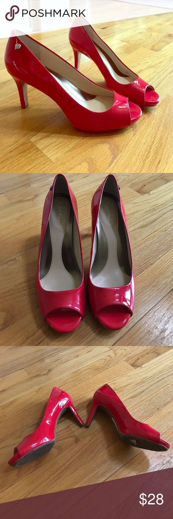 "Calvin Klein Red Patent Peeptoe Pumps Stunning red Calvin Klein Patent peeptoe pumps that will dress up your style! These previously loved shoes will turn heads wherever you go! Slip these on and you'll be ready for your next destination! The shoe shoes mild signs of wear, and some scuffing as pictured. The heel is just shy of 3"". Snag this pair today! Calvin Klein Shoes Heels"