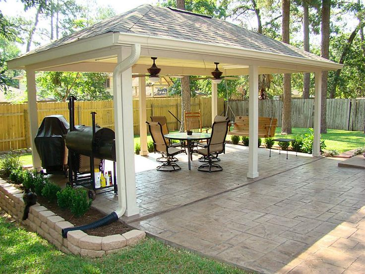 A stamped and stained concrete extension leads you from the back door to this 12' x 20' covered patio