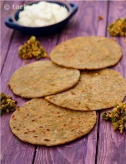 Spicy moong dal and spring onion stuffed whole wheat parathas. Drain out all the water from the soaked moong dal and the excess juices of the stuffing to prevent the parathas from getting soggy. Serve this recipe with the sweet peach pickle or angoor ka murabba.