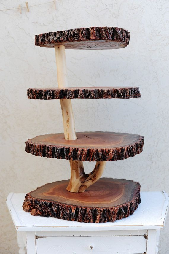 **I love this cake/cupcake stand and I'm sure my dad could make something like it**  Rustic 4 tiered custom wood tree slice by cogdellphotography, $400.00