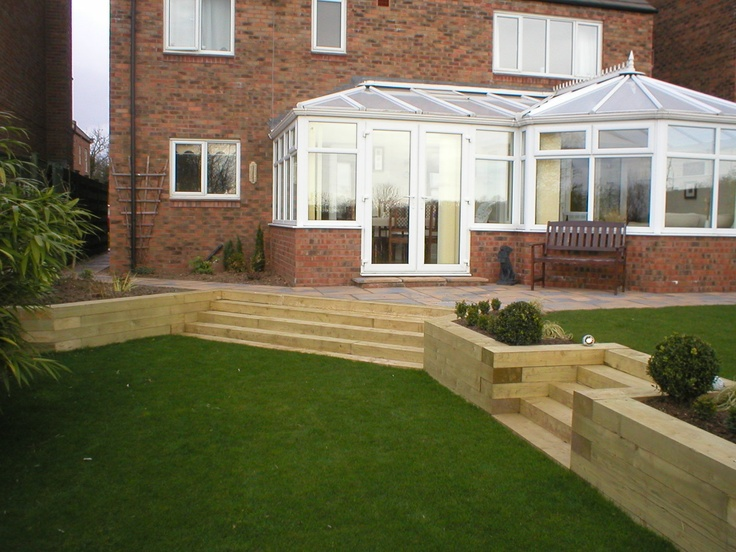 Split level garden in tollerton york using sleepers for Split level garden designs
