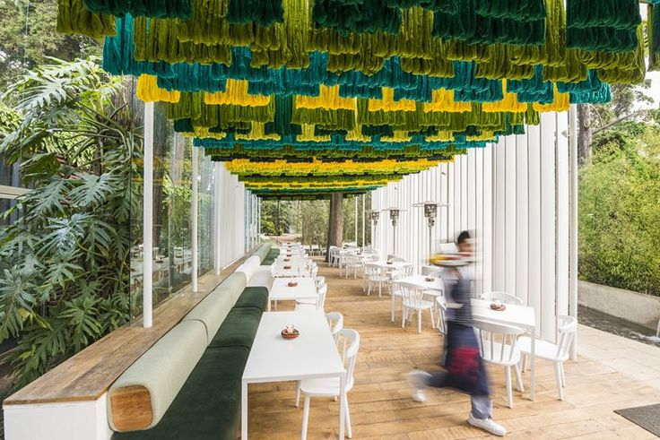 Material characteristics are used in this terrace cafe to heighten the viewer's experience of the natural environment. The colorful canopy, made of 1000 pounds of thread hanging from a steel structure, has tactile qualities of softness, and is...