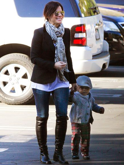 Sandra Bullock - I like the blazer with scarf + blue jeans and boots.  And the aviators are great!