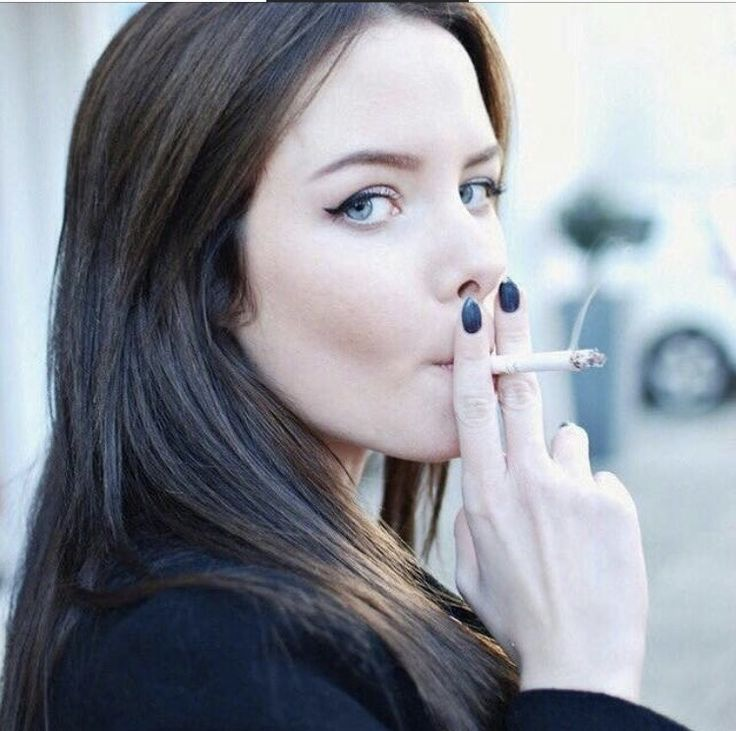 Pretty woman smoking cigarettes