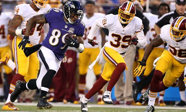 BALTIMORE, MD - AUGUST 29: Wide receiver Steve Smith #89 of the Baltimore Ravens scores a touchdown in the first quarter of a preseason game against the Washington Redskins at M&T Bank Stadium on August 29, 2015 in Baltimore, Maryland.