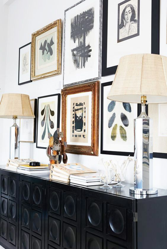Black console with mirrored silver table lamps and gallery wall in Malene Birger's home on Thou Swell @thouswellblog